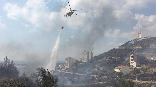 İzmir'de zeytinlik alandaki yangın evlere sıçradı