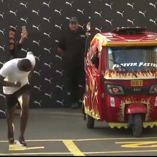 Usain Bolt gösteri yarışında triportöre büyük fark attı
