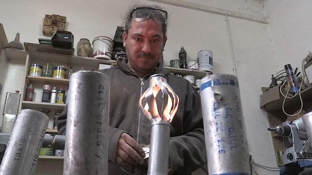 İsrail'in gaz bombaları Filistinli Hilu'nun elinde sanat eserine dönüşüyor